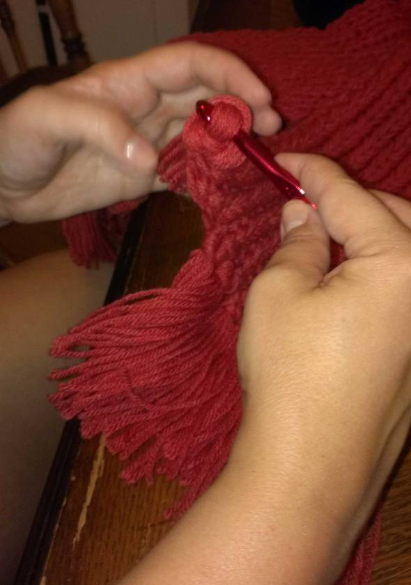Use the crochet hook to draw the loose ends through the loop created on the folded end.