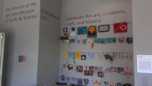 The museum's mission statement, and wall of handcrafted items in the community craft room.